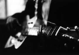 image of man playing guitar
