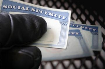 Gloved Thumb Hiding Social Security Number